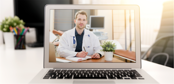 Laptop computer with image of doctor writing on pad